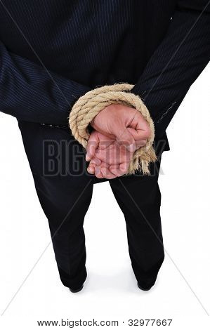 Side view of businessman executive tied up with rope