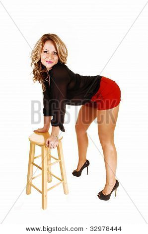 Woman Bending In Chair.