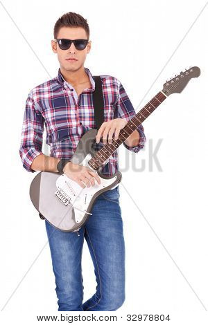 serious man wearing sunglasses holding an electric guitar