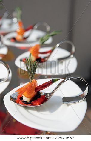 Sun-lit seafood snacks on banquet table