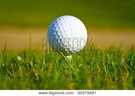 Golf ball on the beautiful golf course with sandbanks