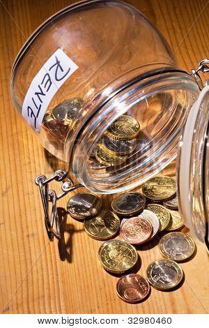 coins in a jar. the provision for old age is always less. poverty in retirement / pension?