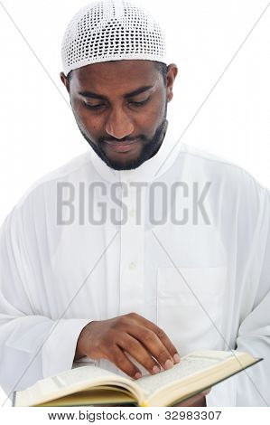Muslim African man reading the Qoran