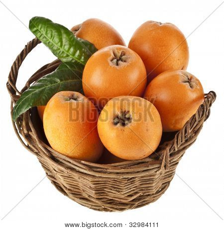 Loquat Medlar fruit in basket isolated on a white background