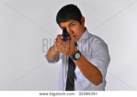 Man isolated on white background aiming at camera