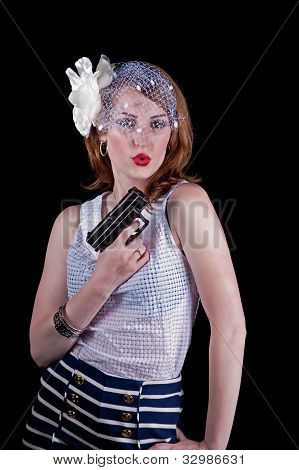 Woman in vintage clothing with a gun