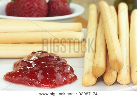 strawberry dessert and bread sticks