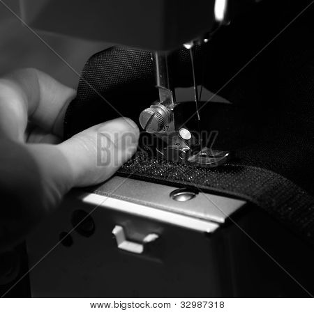Hand Of Seamstress Using Sewing Machine