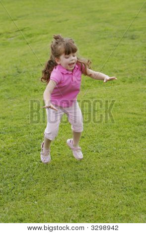 Girl Jumping In Grass
