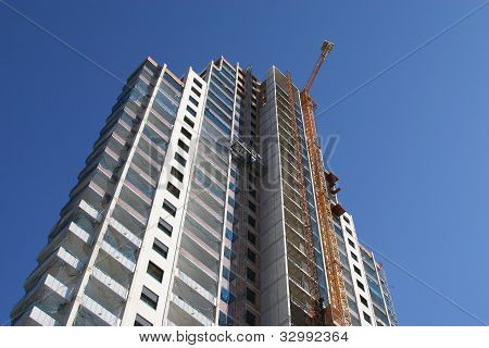 High building with ongoing work.