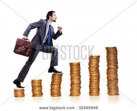 Businessman climbing gold coins stacks