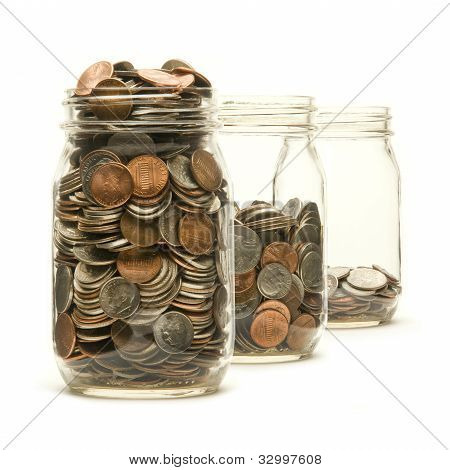 Three Glass Jars Filled With American Coins