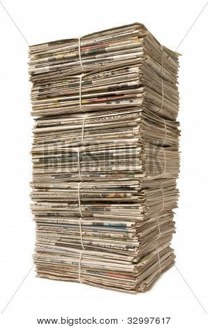 Towering Stack Of Newspapers For Recycling