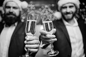 Business People Drink Champagne At Party. Colleagues Celebrate New Year. Men Formal Suits And Santa  poster