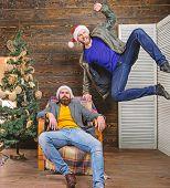 Cheerful Men Having Fun Near Christmas Tree. Christmas Fun. Friends Having Fun On Christmas Eve. Can poster