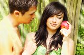 stock photo of garden eden  - Adam and Eve are going to eat an fruit - JPG
