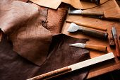 Leather craft or leather working. Large beautifully colored or tanned leather on leather craftmans  poster