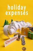Holiday Expenses Concept. Long Twisted Christmas Expenses List, Presents, Gifts, Money Coins And Chr poster