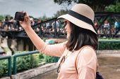 Tourist Woman Having Fun While Sightseeing In Travel Place, Asian Woman Relaxing And Enjoyment While poster