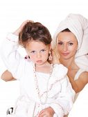 stock photo of housecoat  - Smiling mother styling little girl - JPG