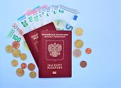 Russian Passports And Europe Money Isolated On White Background. Everything For A Trip To Europe. poster