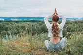 Meditation Outside The City In Nature. Young Woman Meditating Sitting On The Ground. There Is A Plac poster