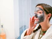 Girl Cares For Oily Skin. Cosmetic Procedures. Skin Care. Young Woman With A Black Mud Mask On Her F poster