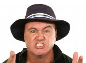 stock photo of angry man  - Angry middle aged man in a blue hat pointing - JPG