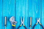 Tools For Master Builder And Accessories On Blue Wooden Vintage Background poster