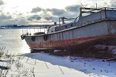 Old Abandoned Wrecked Fishing Boat At Ship Or Boat Graveyard. Lots Of Different Dry Docked, Destroye poster