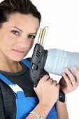 Woman with a blowtorch poster