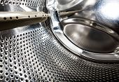 pic of washing machine  - A detail of a washing machine front loading - JPG