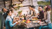 Young People Dining And Having Fun Drinking Red Wine Together On Balcony Rooftop Dinner Party - Happ poster