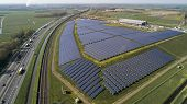 Big Solar Panel Farm With Photovoltaic Panels For Clean Solar Energy poster