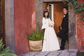 stock photo of quinceanera  - Hispanic girl in Quinceanera dress with chamberlain - JPG