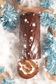 christmas yule log and decoration- festive chocolate pastry with cream poster