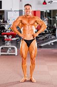 image of body builder  - male bodybuilder flexing his muscle in gym - JPG