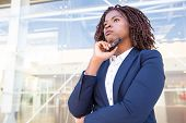 Pensive Serious Professional Waiting Colleague Outside. Young African American Business Woman Standi poster
