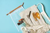 Set Of Reusable Items For An Eco-friendly Lifestyle. Eco Bag, Glass Bottle For Water, Metal Tubes, W poster