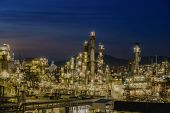 Twilight Sky With Petrochemical Industry Estate, Glitter Lighting Of Petrochemical Industrial On Blu poster