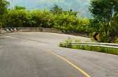 Asphalt Road In Mountains. Curved Road With Turn Road Sign. Winding Road In Thailand With Tropical L poster