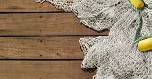 Fishing Net On Wooden Decking Background With Copy Space poster