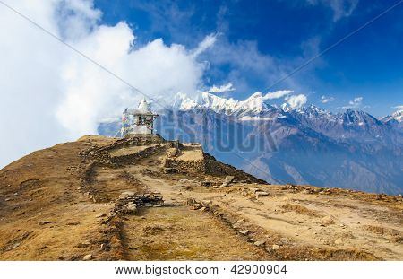 Buddhist stupe or chorten with prayer flags in Himalayas.