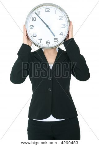 Businesswoman Covering Her Head With Clock
