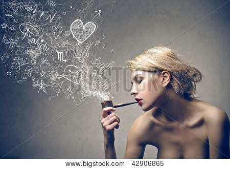beautiful blonde woman smokes pipe