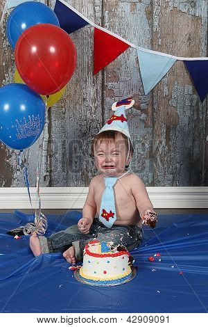Infant boy's first birthday cake smash Adorable baby smashing cake