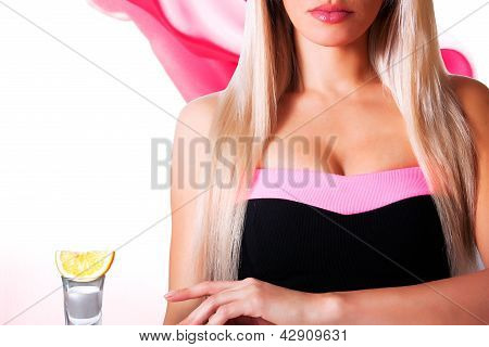 Beautiful Blonde In A Bar Drinking Tequila