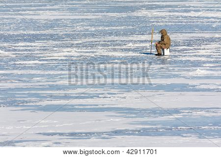 Fisherman On Ice In Winter