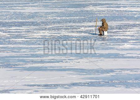 Fisherman On Ice In Winter