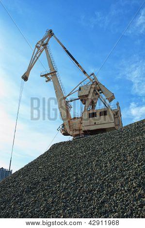 crane at heap of gravel